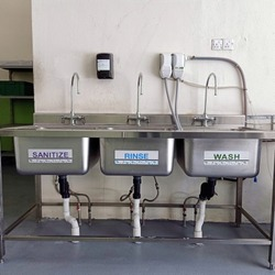 three-compartment stainless steel sink with