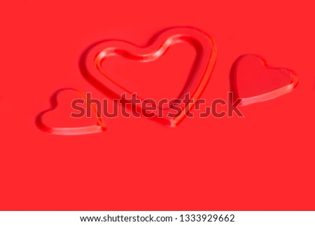Three convex contours of hearts on a red metallic background #1333929662