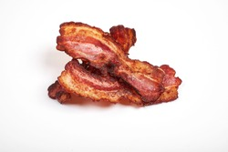 Three cooked, crispy fried bacon isolated on a white background.