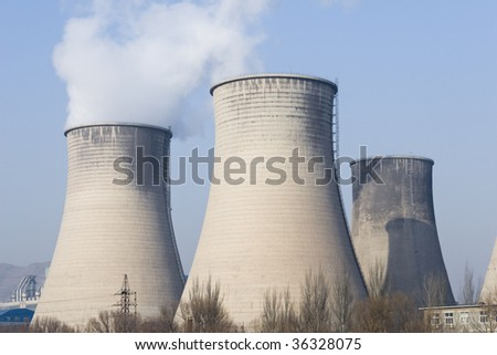 three cooling towers of a power plant in northern china.