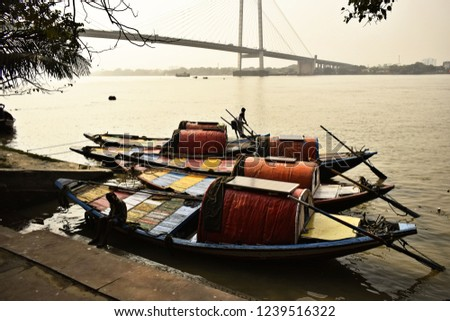 Three country boats queued for passenger at