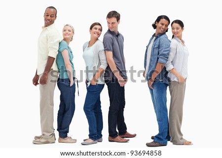 Three couples standing back to back looking at each other against white background