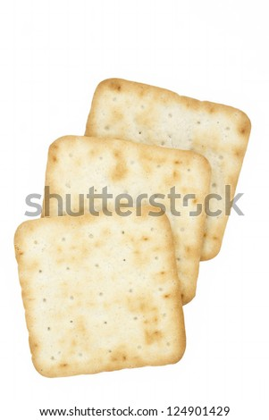 Three cream crackers on a white background
