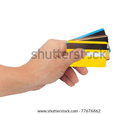 three credit cards in hand - stock photo