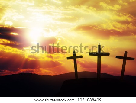 three cross on the hill in cloudy sunset. can be use for Easter or Christian background, copy space #1031088409