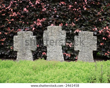 Three cross shaped tombstones without inscription