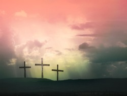 Three crosses against dramatic red sky