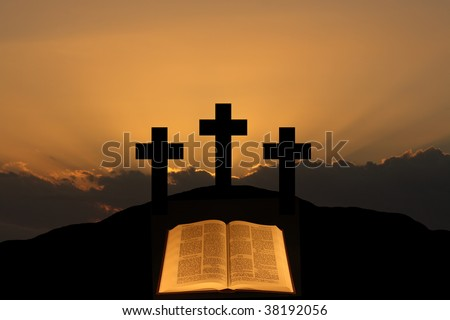 Three crosses on a hill with a bible in the foreground.