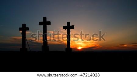 Three crosses on sunset.
