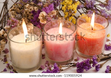 Three cup candles surrounded with dried wavy leaf sea lavender flowers