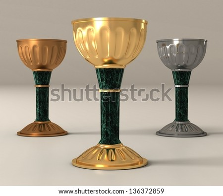 three cups: gold, silver and copper on legs from marble and gold finishing - stock photo