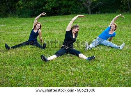 Three cute girls work out in nature