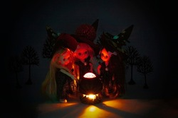 Three cute young witches cooking under the dark night. Walpurgis night and Halloween concept. Modified generic ball-jointed dolls.