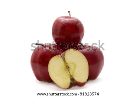 three dark red apples with one half isolated on white background