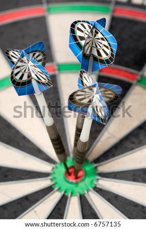 three darts arrows in the bulls eye
