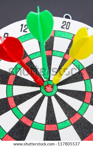 Three darts hitting target