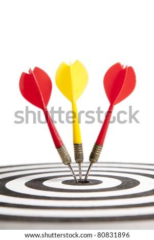 Three Darts hitting the middle of dartboard