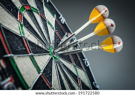 Three darts in the target center