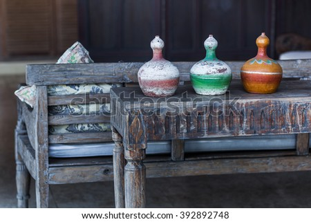 Three decorative vases mexican style on wooden vintage table