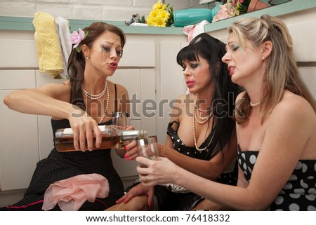 Three depressed woman drinking alcohol