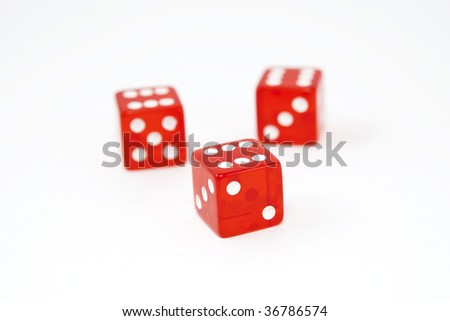 Three dice, all sixes, isolated on white background, shallow DOF