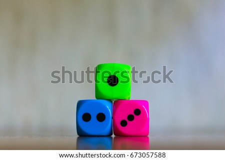 Three dice in a shape of pedestal for contestant awarding for the first, second and third places. Game, gambling, competition concept. #673057588