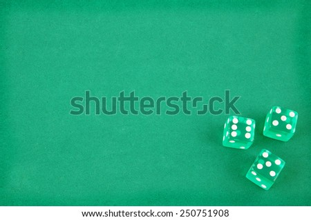 Three dices on green gaming table