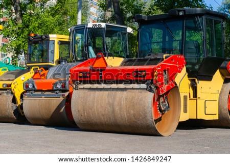 three diesel road rollers rinks standing on the street