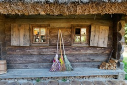 three different brooms of witches stand at the house