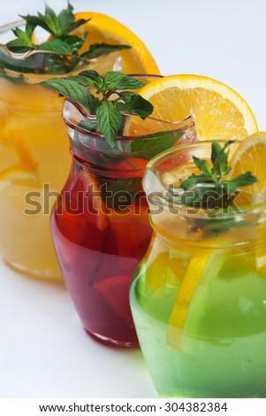 Three different cold drinks Fresh juice mix Three of fruit cocktails. Fruit cold tea cocktails.