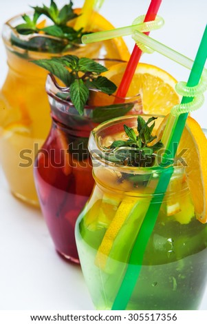 Three different cold drinks Fresh juice mix Three of fruit cocktails. Fruit cold tea cocktails on white background.