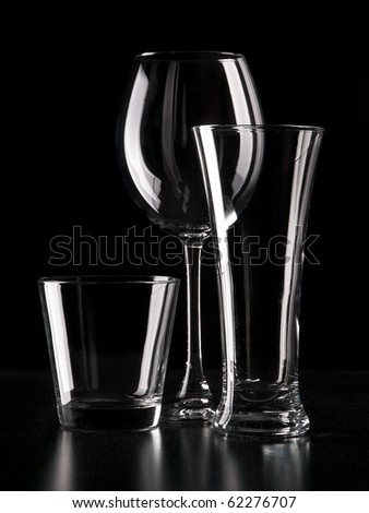 Three different glasses like a light contour of  in dark color