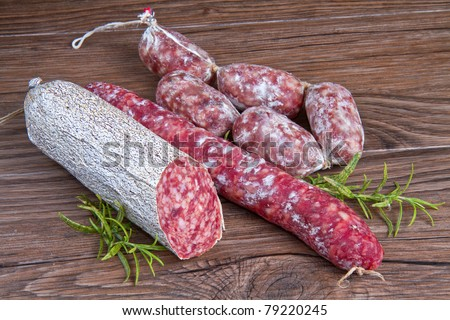 three different kind of salami on wooden table