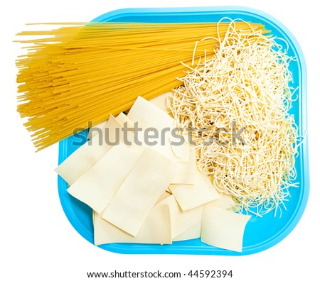 Three different kinds of pasta in plate isolated.