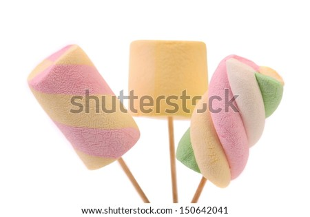 Three different marshmallow on a sticks. White background.