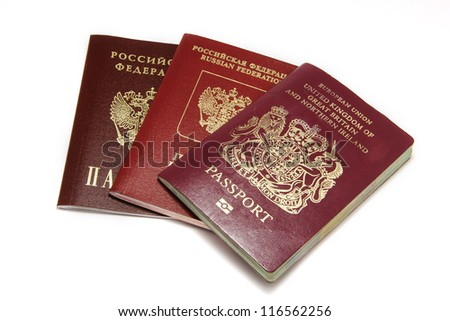 Three different passports isolated on white