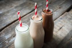 Three Different Sorts Beverage Milk Cocoa Chocolate Bottle Wooden Background