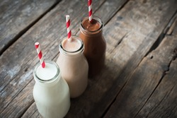 Three Different Sorts Beverage Milk Cocoa Chocolate Bottle Wooden Background Top View