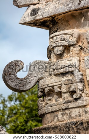 Three-dimensional mask on the edge of the Nunnery Annex building in Chichen Itza, believed to be the Ancient Mayan god of rain and lightning Chac. #568000822