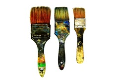 Three dirty paintbrushes be stained color isolated on white background. Artist's paintbrush