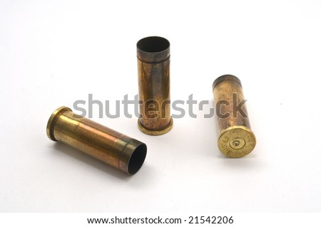 Three dirty .38 special revolver casings