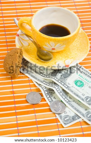 Three dollars and 50 cent pay for coffee and cookies on bamboo table-cloth #10123423