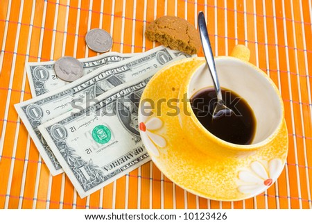 Three dollars and 50 cent pay for coffee and cookies on bamboo table-cloth #10123426