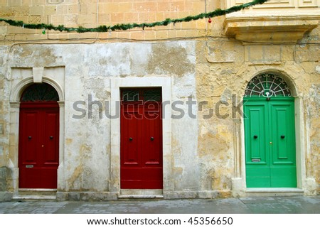 Three doorways in Maltese houses Malta. - stock photo