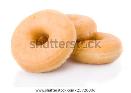 Three doughnuts or donuts piled isolated on white - stock photo