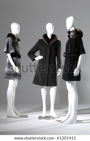 Three dummies dressed fashion fur coat winter in suits