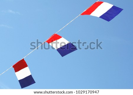 Three Dutch flags waving in blue sky, national holidays, Liberation day (Bevrijdingsdag) and sport events