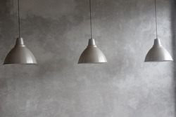 Three electric lamps of gray color on a gray background.