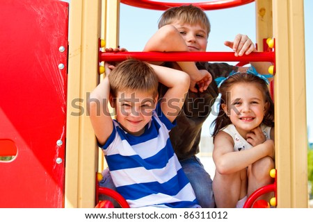 Three elementary aged children in the playground