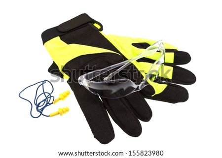 Three elements of the Personal Safety Equipment: Gloves, Safety Glasses, Ear Plugs  - stock photo